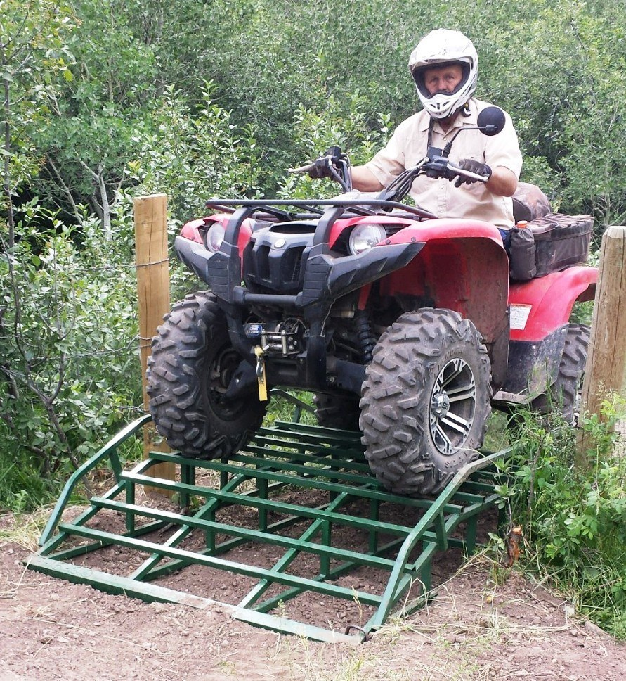 mel four wheeler on atv guard w trees.jpg
